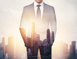 double exposure of businessman and city