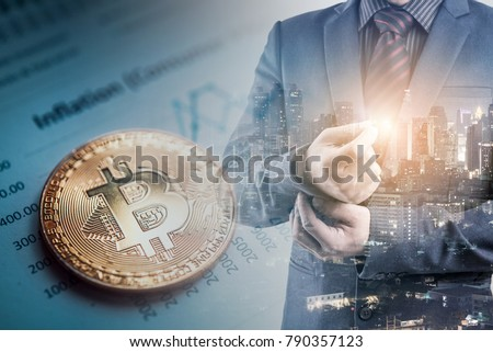 Double exposure of businessman and city night background with bitcoin on graph report, bitcoin BTC the new virtual electronic money. investment concept