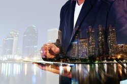 Double Exposure of BusinessMan and City with Business Meeting as Teamwork or Partnership Concept.