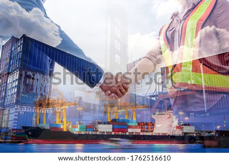 Double exposure of businessman and engineer wear a hardhat standing cargo at the container yard and greeting each other with handshake on construction site Cargo freight ship for import and export.