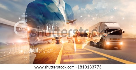 Double exposure of businessman and graph growth of business with world map of transportation and logistics network distribution and trucks of industrial cargo freight for shipping. import-export.