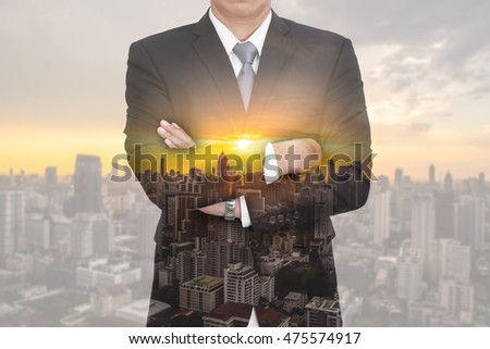Double exposure of businessman arms crossed, urban, cityscape and sunset  as vision of leader concept. #475574917
