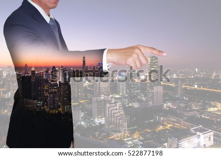 Double exposure of businessman finger point goal, cityscape, urban and street in the night as business and target concept. #522877198