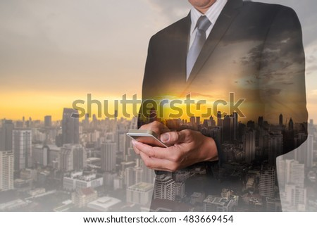 Double exposure of businessman hand hold smart phone, mobile, cityscape and sunset as business, communication and technology concept. #483669454