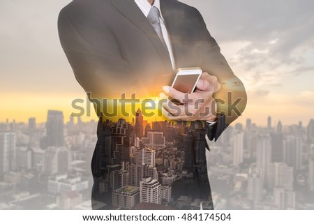 Double exposure of businessman hand hold smart phone, mobile, cityscape and sunset as business, communication and technology concept. #484174504