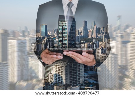 Double exposure of businessman hand hold tablet and city at the morning on blurred abstract city camera zoom background as technology and communication concept. #408790477
