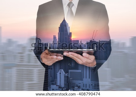Double exposure of businessman hand hold tablet, cityscape and sunset on blurred motion abstract city background as technology and communication concept. #408790474