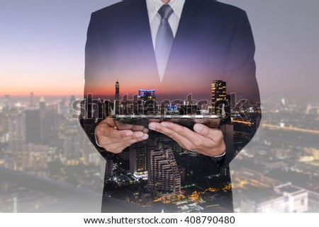 Double exposure of businessman hand hold tablet, night street and night city as technology and communication concept. #408790480