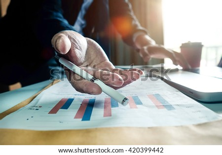 double exposure of businessman hand working on laptop computer on office desk with social media network diagram in morning light.vintage effect