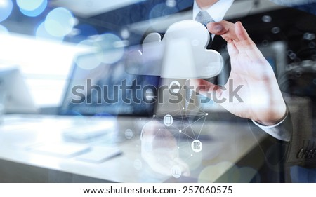 Double exposure of Businessman hand working with a Cloud Computing diagram on the new computer interface as concept #257060575