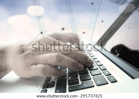 double exposure of businessman hand working with business documents on office table with laptop computer with social media diagram #295737425
