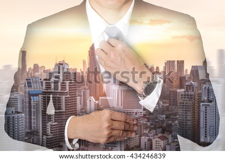 Double exposure of businessman held necktie dress to look good, cityscape, urban and sunset at evening as preparation and leadership concept. #434246839