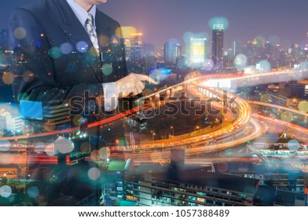 Double Exposure of Businessman Hold Digital Tablet and Modern Capital City of Bangkok at Twilight with Expressway or Superhighway as Smart City Lifestyle concept Stock photo ©