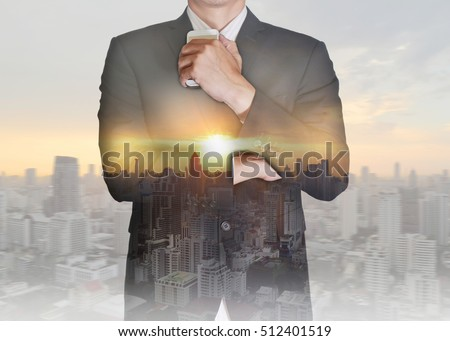 Double exposure of businessman stand up and think idea about business, cityscape and sunset as thoughtful concept. #512401519