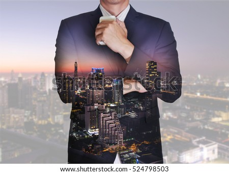 Double exposure of businessman stand up and think idea about business, cityscape, urban and street in the night or twilight as thoughtful concept. #524798503
