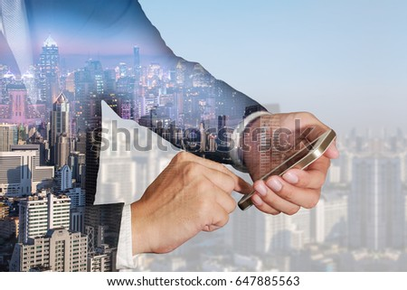 Double exposure of businessman use smartphone, cityscape, urban in the night and the day as business, Technology, telecommunication and Communication concept. #647885563