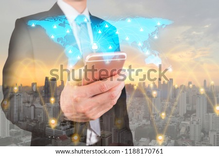 Double exposure of businessman use smartphone, communication 4G 5G node networking telephone cellsite, world map and cityscape urban at sunset as business, technology and telecom concept