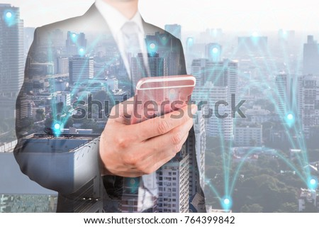 Double exposure of businessman use smartphone, communication 4G 5G node networking telephone cellsite and cityscape urban at foggy morning as business, technology and telecom concept #764399842