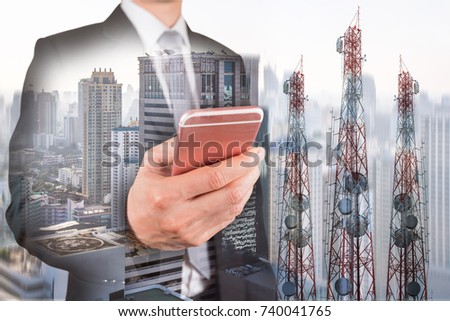 Double exposure of businessman use smartphone, communication tower or 4G 5G network telephone cellsite and foggy cityscape urban background as business, technology and telecom concept #740041765
