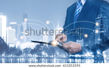 Double exposure of businessman usiing tablet to download and transfer information, network connection and technology concept. #611053595