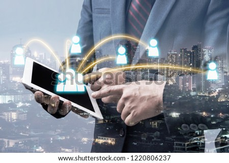 double exposure of businessman using tablet to connect with other people with blur city night background, network business connection concept. #1220806237