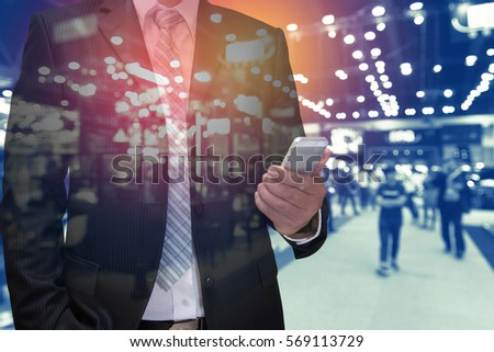 double exposure of businessman using tablet with blurred people in event background - Shutterstock ID 569113729