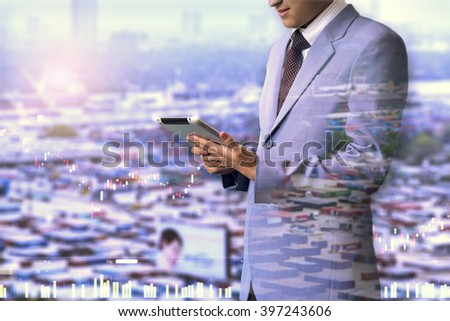 Double exposure of businessman using the tablet with Pier of trade and financial graph on blurred Pier of trade background, Business Trading concept #397243606