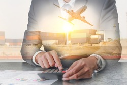 Double exposure of businessman working with calculator, Container Cargo ship, Cargo plane and airplane take off at sunset as business, Calculation, industrial, transportation and import export concept