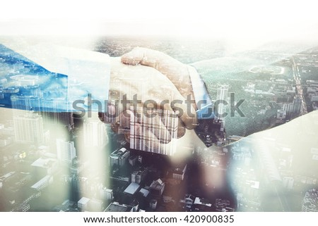 Double Exposure of Businessmen in suit handshaking agreed upon partnership