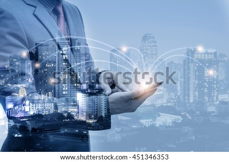 double exposure of businessmen using smart phone with blur city night and network connection concept  #451346353