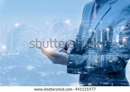 double exposure of businessmen using smart phone with blur city night and network connection concept