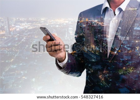 double exposure of businessmen using smart phone with city night and network connection concept #548327416