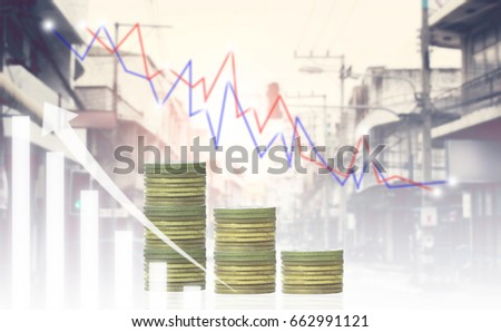 Double exposure of Businessmen with gold coins.financial graph