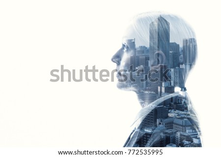 Double exposure of businesswoman and cityscape.