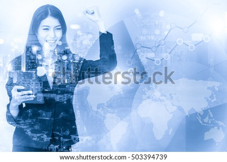 Double exposure of businesswoman with raised arms cheering with city and business chart. Success concept. Elements of this image furnished by NASA