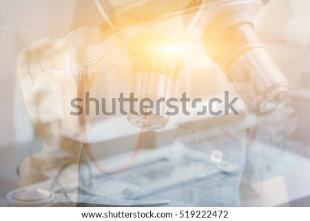Double exposure of chemistry microscope, biology, medicine and people concept,doctor hand with Stethoscope making research in clinical laboratory,chemical liquid, science research,vintage color