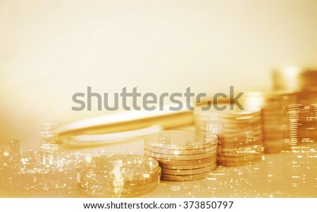 Double exposure of city and rows of coins for finance and banking concept