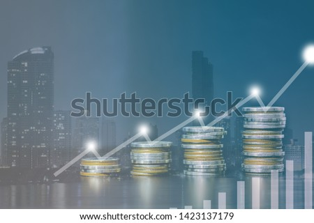 Double exposure of city and rows of coins for money, finance and business concept of teamwork and partnership. ECN Digital economy, best, technology, Industry.