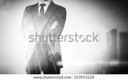 Double exposure of city and young businessman