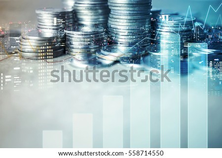 Double exposure of city , graph and rows of coins for finance and business concept