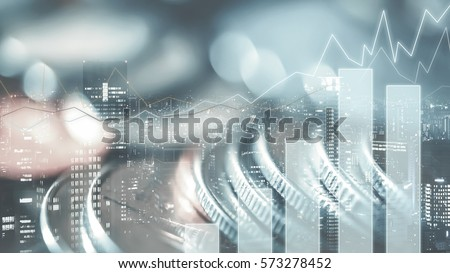 Double exposure of city, graph and rows of coins for finance and business concept