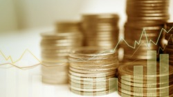 Double exposure of city, graph and rows of coins for money, finance and business concept