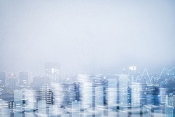 Double exposure of city, graph, rows of coins and blank space for finance and business concept
