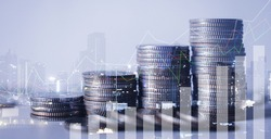 double exposure of city with row of coin stack with growth chart and graph progress report for business investment finance banking and money saving concept.