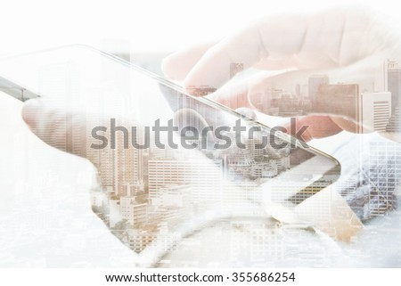 Double exposure of cityscape and smart phone, communication technology concept.  #355686254