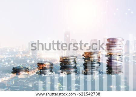 Double exposure of coins and city background for finance and banking concept #621542738