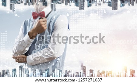 Double exposure of confident and young businessman in smart-casual wear smoking pipe and modern cityscape with business and media interface. Concept of new technologies for modern business. #1257271087