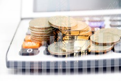 Double exposure of construction and graph on rows of coins for finance and businessconcept