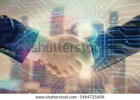 Double exposure of crypto economy theme drawing on cityscape background with handshake. Concept of partnership and blockchain #1464725606