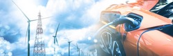 Double exposure of electric car charge battery with wind turbine pole and blue sky blur bokeh on panoramic background. idea nature electric energy to generate electricity. Green energy eco concept.